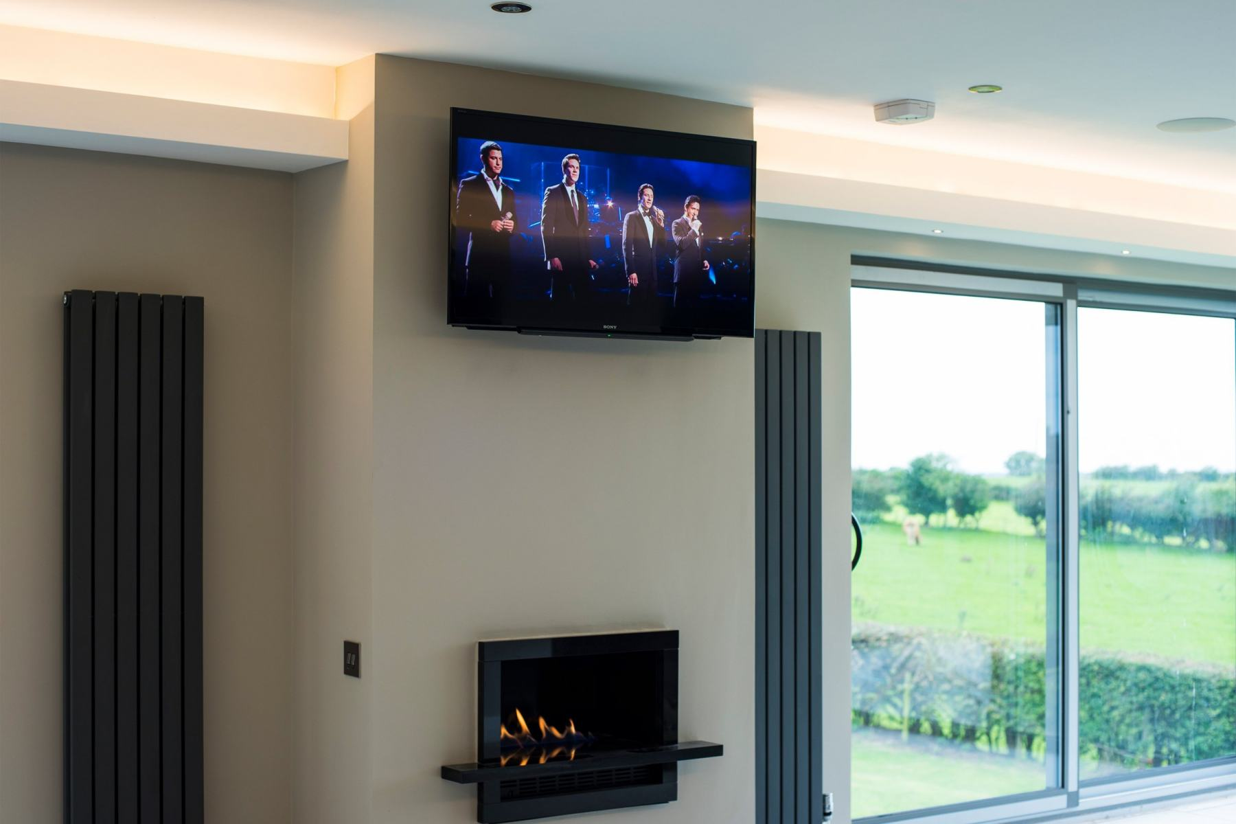 On wall television in smart home