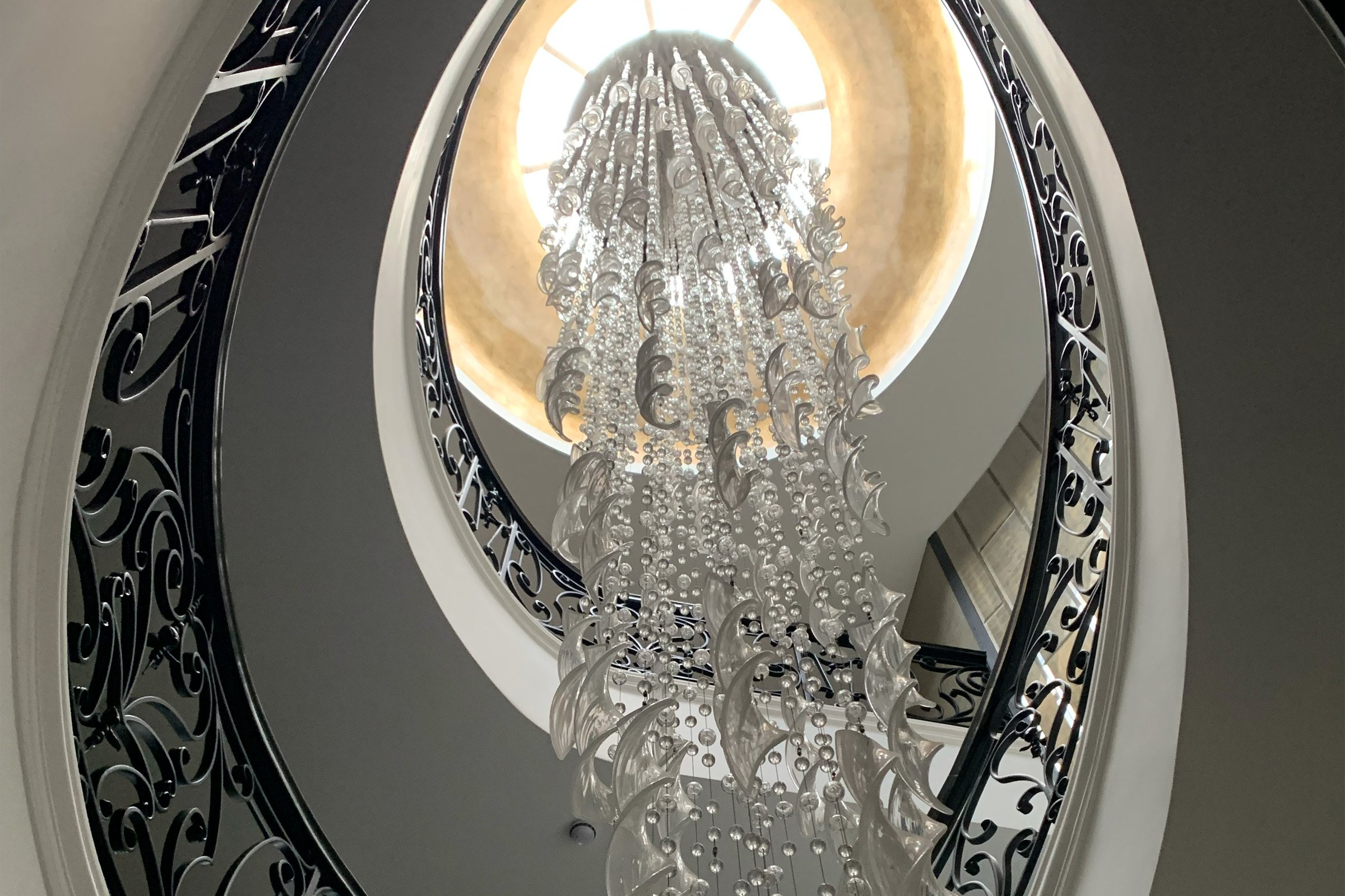 Statement chandelier with Lutron lighting control