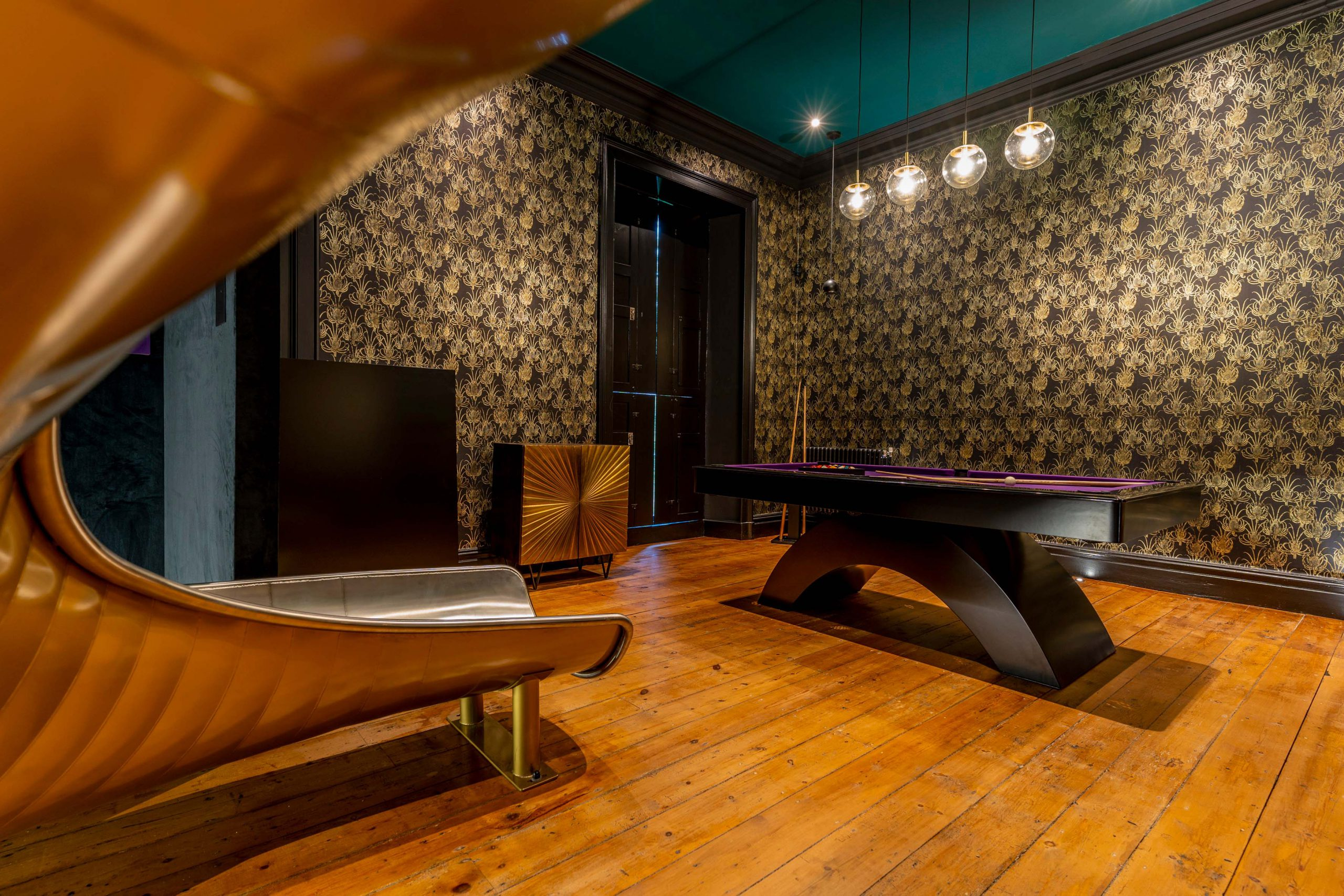 Entertainment room with slide, with Control 4 and Gallo Acoustics speakers