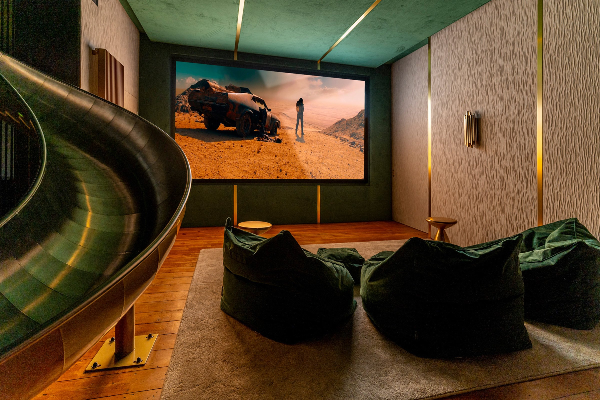 Luxury cinema and entertainment room featuring stretch fabric walls and luxury AV systems