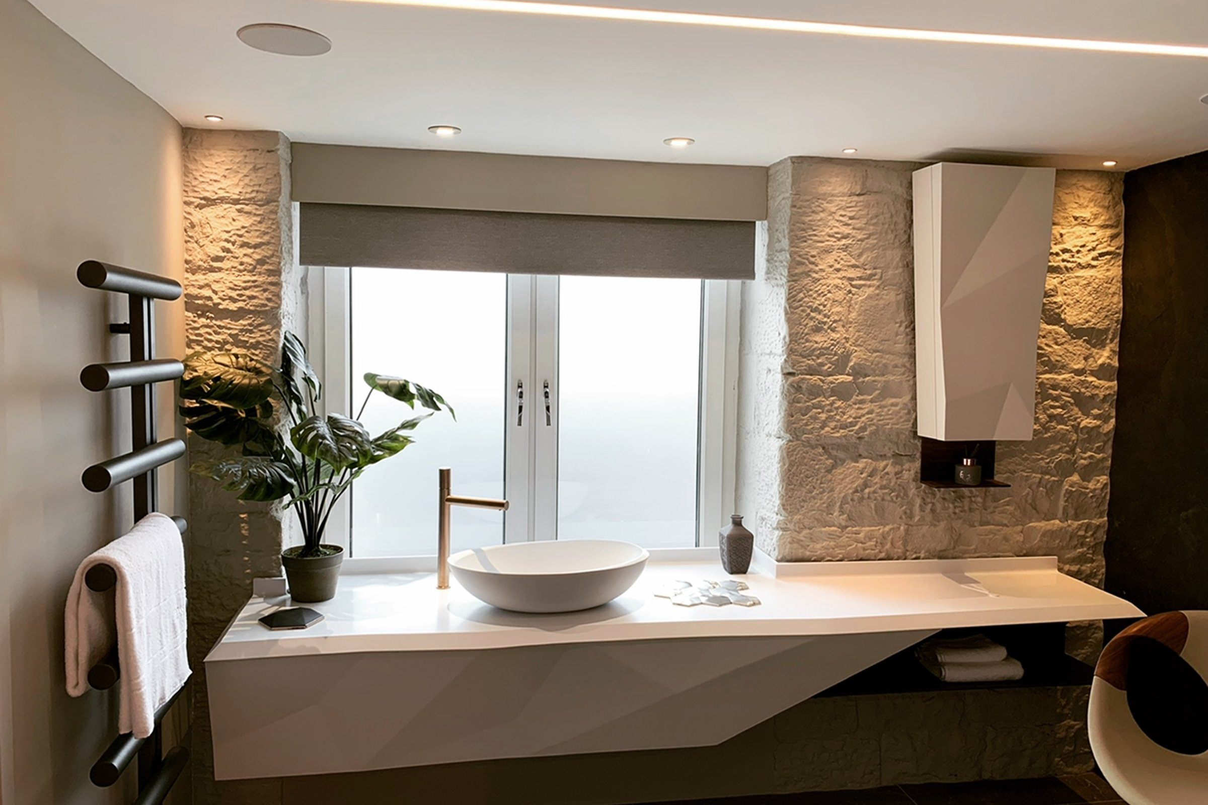 Designer bathroom featuring Rako lighting control and Sonance in-ceiling speakers
